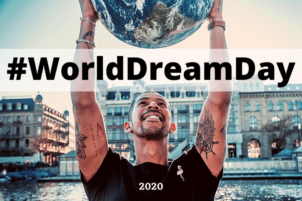 Uomo mappamondo giornata mondiale sogni con scritta #Worlddreamday
